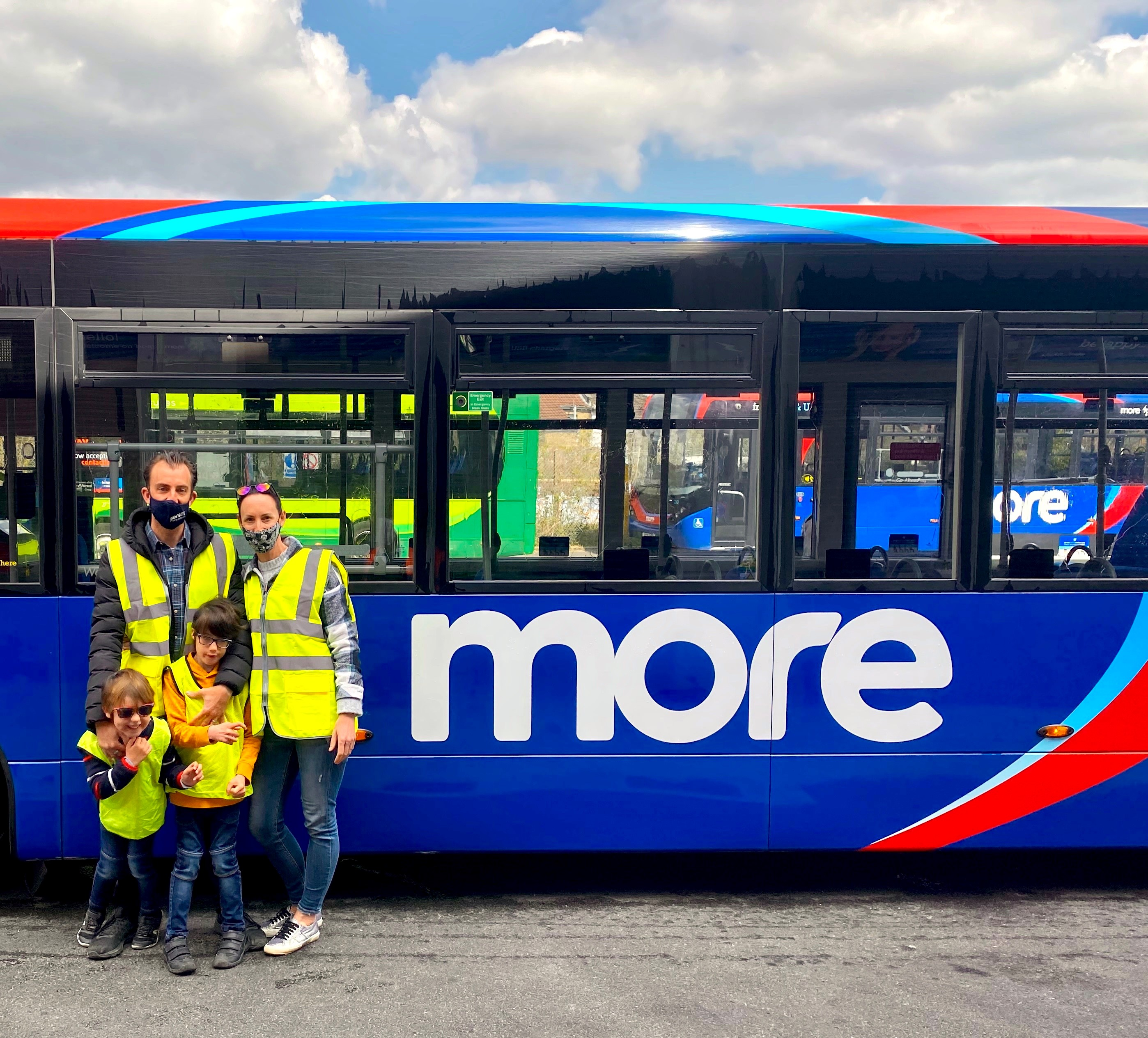 Image of a morebus pictured with Jenson Sutton (bottom right) with parents Matt and Emily, and brother Coby.