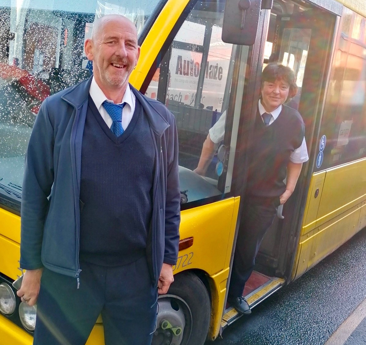 Photo of two drivers, Simon and Dawn, outside a Cango bus